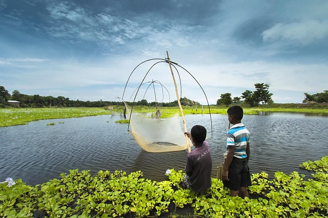 Small kids are fishing, Why visit Northeast India