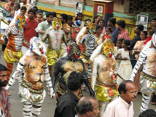 The Pulikkali tiger play in Thrissur is definitely the quirkiest festival in Kerala.