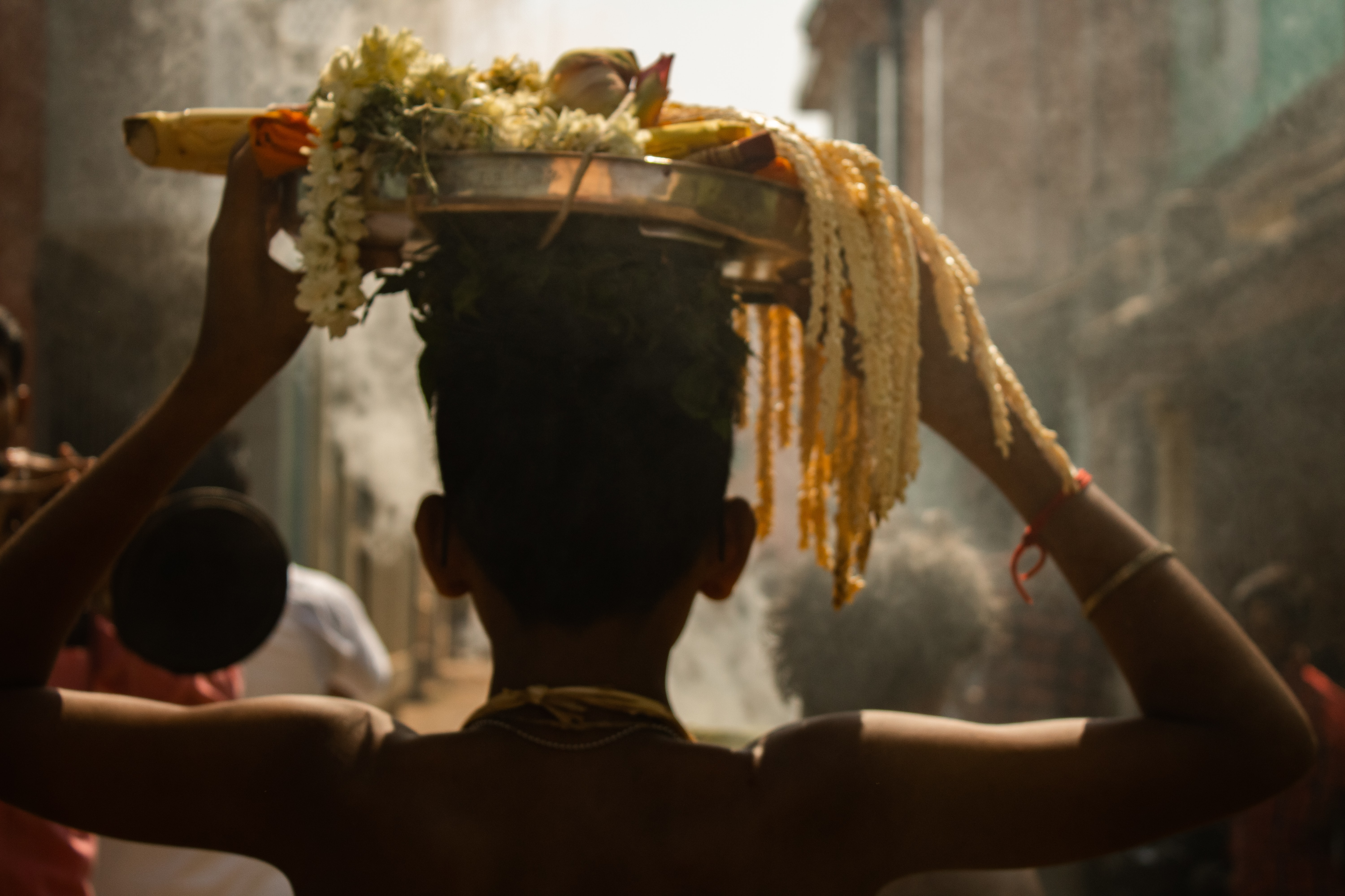 Boy carrying flowers outside Tanjore Temple, things to do in Tanjore